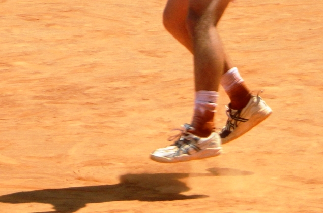 Tennis Player Legs and Shadow